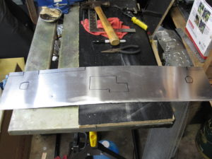 Aluminum cowl with markings transferred.